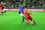 http://commons.wikimedia.org/wiki/File:Luis_Suarez_runs_at_Distin_4.jpg